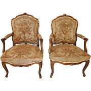 Pair of Louis XV style Aubusson painted and gilded arm chairs