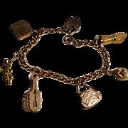 Victorian goldfilled charms bracelet - purse, fan, locket, etc.