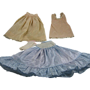Handmade dress with two slips, and white cotton socks.