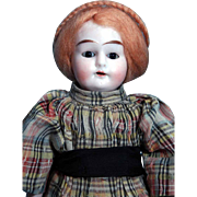 "Alma bisque head 11"" tall doll with brown stationary eyes, open mouth with teeth and ..."