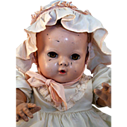 "Dy Dee Baby by Effanbee Rubber Circa 1940 20"" long with blonde Caracul wig"