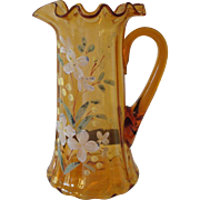 REDUCED Hand blown Amber Pitcher with ruffled edge.