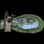 A Johillco lead farm pond with bridge, ducks and dovecote, 1930s