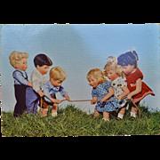 A wonderful Kathe Kruse postcard of a tug of war, German Child