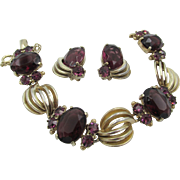 Signed Schiaparelli Purple Rhinestone Gold Plated Bracelet and Earrings
