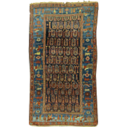 SOLD An early 20th C. Persian Village Rug with Boteh Decoration