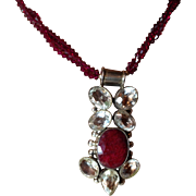 SALE 15 carat Indian Ruby necklace Bicone bead surrounded with clear full cut stones.