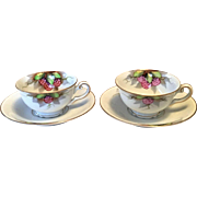 Set of two demi-tasse cup and saucer, bone china, hand painted.