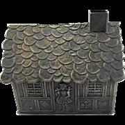 Vintage Pressed Steel Gingerbread House Bank
