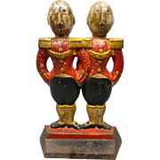 Cast Iron Footmen Doorstop.  Designed by Anne Fish and made by Hubley.