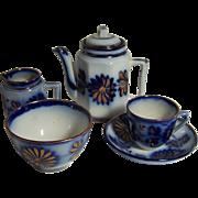 Tea Set w/ teapot, cup, saucer, creamer and bowl