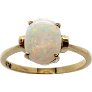 Ladies 10K Fiery Opal Ring set in a Simple Classic 4 Prong Setting in YG