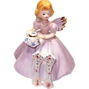 Vintage JOSEF Original 11th Birthday figurine, In Lavender  holding purse