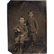 Antique Tin Type Photo Two Young Boys Suits Boots Serious Expressions Slicked Down Hair 1890s
