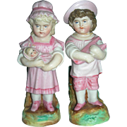 "4 3/4"" Tall Brother & Sister Vases with toys"
