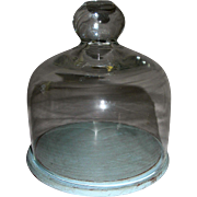 Small Bell Shaped Dome and Wooden stand for displaying dolls.