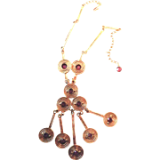 Goldette Modernist Necklace with Amethyst Colored Crystals in Gold Colored Metal