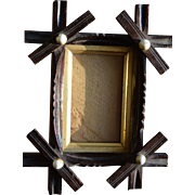 Small 19th century tramp art criss cross picture frame with ceramic buttons.