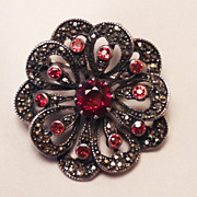 Vintage Sterling Silver Flower Brooch/Pendant set with Marcasites and Garnets.