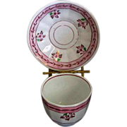 Early English Pink luster handleless cup and saucer flowers