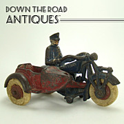 Cast Iron Champion Police Motorcyclist with Side-car