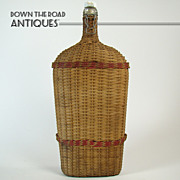Large Wicker Wrapped Bottle with Porcelain Flip-Top - 1880's