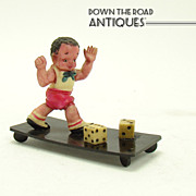 Celluloid Black Boy Playing Dice Figurine - 1920's