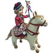 SOLD German bisque girl on a vintage horse, 4th of July or patriotic