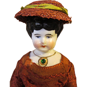 """Small china head with molded necklace, 8"""" tall"""