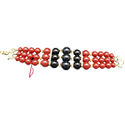Wide bead bracelet Lucite Fake Carnelian and Onyx Gold tone