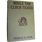"Hardy Boys, ""While The Clock Ticked"" by Franklin Dixon, Grosset & Dunlap 1932 Orange"