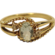 Lovely Blue Topaz Ring with Diamond Accents in 10K Yellow Gold