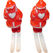 Colorful Santas on Skis with a Sack of Presents
