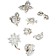 "1967 ""LITTLE WHITE TRIFARI FIGURAL COLLECTION"" White Enamel/White Cabochon Figural B"