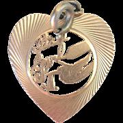 ".Vintage 14kt 'It's a Girl"" Stork Heart Charm"