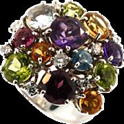 18 kt White Gold Multi Gemstone Cluster Ring.
