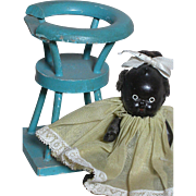 Black Bisque Dollhouse Doll Japan Dressed Black Baby sitting in Wood Round Chair
