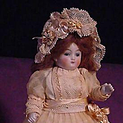 "6"" All Bisque German Child In Elaborate Fancy Dress"