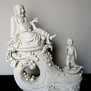 Chinese Blanc de Chine Budai Seated on a Wave
