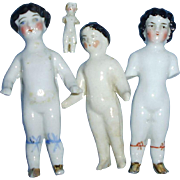 Four Antique German China Frozen Charlotte Dolls as is