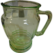 REDUCED Green Depression glass pitcher has grapes etched  on it