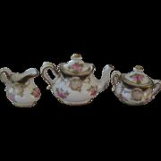 Crown Staffordshire Teapot, creamer and sugar bowl