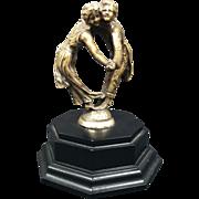 Les Danseurs Tete A Tete French Mascot Hood Ornament Signed Ruffony
