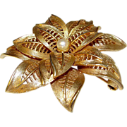 Boucher Designer Flower Brooch with a Faux Pearl Accent