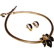 DIOR Designer Floral Necklace and Clip On Earrings Set in Gold Plated Finish with Black Enamel