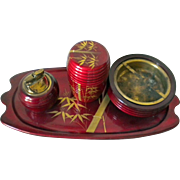 REDUCED Vintage Japan red lacquer smoking set including tray, ashtray, lighter and cigarette .