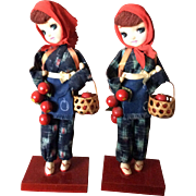 Twin girl apple picker dolls from Japan with head scarves and fur jackets