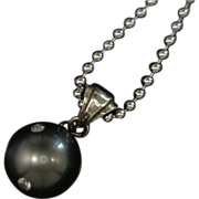 Artisan Black Pearl Pendant Studded with Diamonds  14 karat gold Earrings