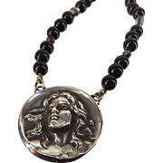Art Nouveau Woman with Flowing Hair Pendant Suspended from an Artisan made 21 Inches Long Blac