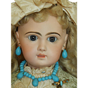 Antique Jumeau blue doll jewelry